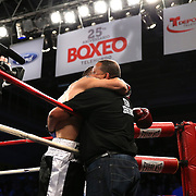 """Juan Castillo (white stripe) fights Luis Garcia during the """"Boxeo Telemundo"""" boxing match at the Kissimmee Civic Center on Friday, March 14, 2014 in Kissimmme, Florida. (Photo/Alex Menendez)"""