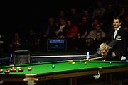 20.02.2016. Cardiff Arena, Cardiff, Wales. Bet Victor Welsh Open Snooker semi-finals. Mark Allen versus Neil Robertson. Neil Robertson attempts a long pot.