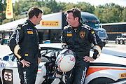 October 3-5, 2013. Lamborghini Super Trofeo - Virginia International Raceway. #63 Justin Bell talks with Kevin Conway of Change Racing, Lamborghini of the Carolinas