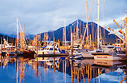 Alaska. Sitka. RA. Sealing Cove Harbor, sunset and rainbow, Japonski Island.