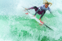 HUNTINGTON BEACH, CA/USA (Friday, June 25) –  Surfer Laura Enever of Australia surfs during round 4 heat 1 at the 2013 Vans U.S. Open of Surfing. Laura defeated  Stephanie Gilmore of Australia with a score of 12.70 points. She now moves to quarter finals against Courtney Conlogue of USA . PHOTO © Eduardo E. Silva/SILVEXPHOTO.COM.