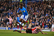 Sunderland Defender, Jack Baldwin (15) tackles Portsmouth Midfielder, Jamal Lowe (10) during the EFL Sky Bet League 1 match between Portsmouth and Sunderland at Fratton Park, Portsmouth, England on 22 December 2018.