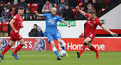 Marcus Maddison of Peterborough United in action with Nicky Devlin and Joe Edwards of Walsall - Mandatory by-line: Joe Dent/JMP - 27/04/2019 - FOOTBALL - Banks's Stadium - Walsall, England - Walsall v Peterborough United - Sky Bet League One