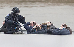 © Licensed to London News Pictures.19/03/2017.London, UK. Passengers put their hands on their heads as armed police take control of a cruise boat during an ant-terrorist training exercise on The River Thames in London. It is the first time that an exercise of this type has taken place on the river.Photo credit: Peter Macdiarmid/LNP