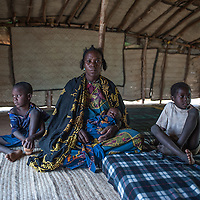 Fadimata Wallet Aboubacrine, 37, from Intilit at her tent at the Malian refugee Goudebou camp, Burkina Faso on 6 May 2014. Fadimata left Mali with her husband, three children and donkey in 2012 and has lived in the camp since then.