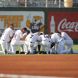 09 June 2008:  LSU players kneel to pray prior to their match up against UC Irvine. The LSU Tigers advanced to the College World Series with a 21-7 victory over the UC Irvine Anteaters in game three of the NCAA Baseball Baton Rouge Super Regional Alex Box Stadium in Baton Rouge, LA..