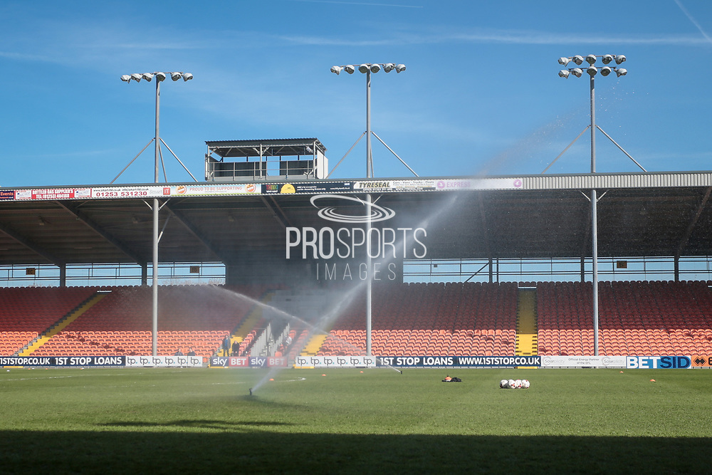 General view of the stadium. Despite the pitch holding a lot of water around the touchlines, the club are watering the pitch before the EFL Sky Bet League 2 match between Blackpool and Hartlepool United at Bloomfield Road, Blackpool, England on 25 March 2017. Photo by Mark P Doherty.