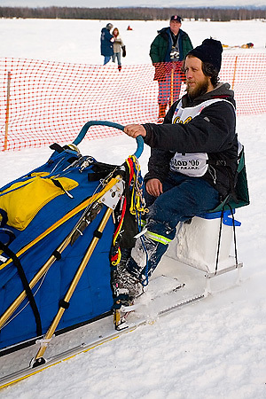 05 March 2006: Willow, Alaska - Sebastian Schnuelle of Whitehorse, Yukon Canada sits on the built in seat on his sled during the restart of the 2006 Iditarod on Willow Lake in Willow, Alaska