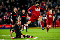 Jose Gimenez of Atletico Madrid tackles Mohamed Salah of Liverpool - Mandatory by-line: Robbie Stephenson/JMP - 11/03/2020 - FOOTBALL - Anfield - Liverpool, England - Liverpool v Atletico Madrid - UEFA Champions League Round of 16, 2nd Leg