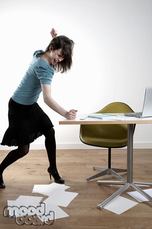 Furious woman hitting desk