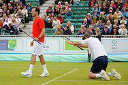 Picture by Ste Jones/Focus Images Ltd.  07706 592282.23/06/12.Peter Fleming bows down to Greg Rusedski during a exhibition doubles match at the +medicash Liverpool International 2012 tennis at Calderstones Park, Liverpool.