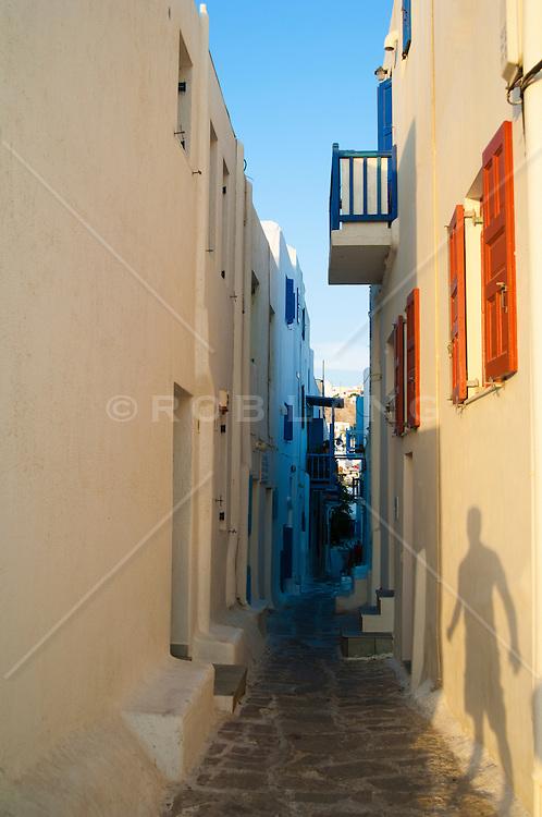 shadow of a man on a building in Mykonos, Greece