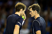 Andy Murray of Great Britain and Jamie Murray of Great Britain confer before a point during the 2016 Davis Cup Semi Final between Great Britain and Argentina at the Emirates Arena, Glasgow, United Kingdom on 17 September 2016. Photo by Craig Doyle.