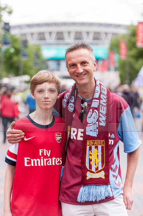 © Licensed to London News Pictures. 30/05/2015. London, UK. A father and son, supporting each of the finalists, are amongst the fans gathering at Wembley Stadium for the FA Cup Final 2015, between Arsenal and Aston Villa. Photo credit : Stephen Chung/LNP
