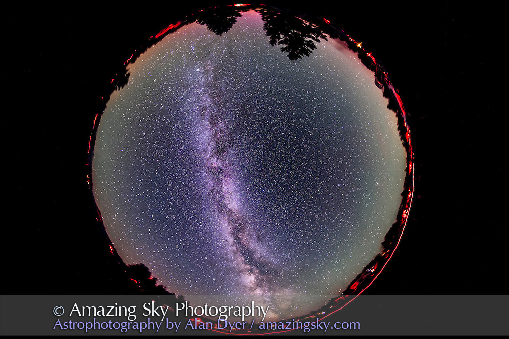 The summer Milky Way across the entire sky, 180° x 360°, in a fish-eye view taken at the Saskatchewan Summer Star Party, August 2012. This is a stack of five x 5 minute exposures at f/4.5 and ISO 1600 with the Sigma 8mm lens and Canon 5D MkII camera. All tracked. The ground is from one exposure; the ground in the other 4 exposures was masked out to minimize blurring of the ground over the 25 minutes of exposure time. A faint aurora and airglow adds some horizon colour.