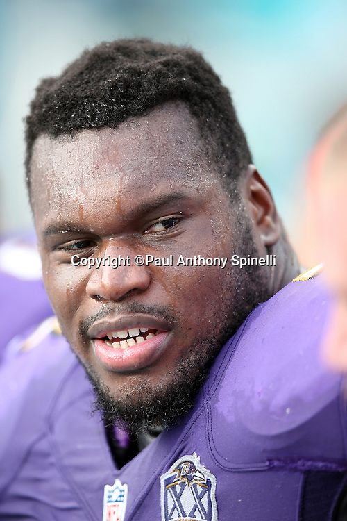 Baltimore Ravens guard Kelechi Osemele (72) looks on from the sideline during the 2015 week 13 regular season NFL football game against the Miami Dolphins on Sunday, Dec. 6, 2015 in Miami Gardens, Fla. The Dolphins won the game 15-13. (©Paul Anthony Spinelli)