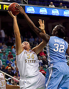 North Carolina Waltiea Rolle (32) blocks Florida State's Cierra Bravard (54) shot during UNC's 78 - 65 victory during second round action in the 2011 ACC Women's Basketball Tournament held at the Greensboro Coliseum in Greensboro, North Carolina.  (Photo by Mark W. Sutton)