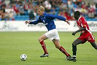 Fotball, 21. juli 2003, Vålerenga-Brann 0-2. Espen Næss Lund, Vålerenga, og Seyi George Olofinjana, Brann
