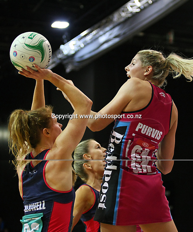 Steels Storm Purvis, right, defends Vixens Tegan Caldwell's shot at goal in the ANZ championship netball match, Steel v Vixens, ILT Stadium Southland, Invercargill, New Zealand, Saturday, May 31, 2014. Photo: Dianne Manson / www.photosport.co.nz
