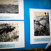NAGASAKI, JAPAN - AUGUST 9 : Students look at old photos of atomic bomb victims exhibited at Nagasaki Peace Park in Nagasaki during the 71st anniversary of the atomic bombing on Nagasaki, southern Japan, Tuesday, August 9, 2016. Japan marked the 71st anniversary of the atomic bombing on Nagasaki. On August 9, 1945, during World War II, the United States dropped the second Atomic bomb on Nagasaki city, killing an estimated 40,000 people which ended World War II. (Photo by Richard Atrero de Guzman/NURPhoto)