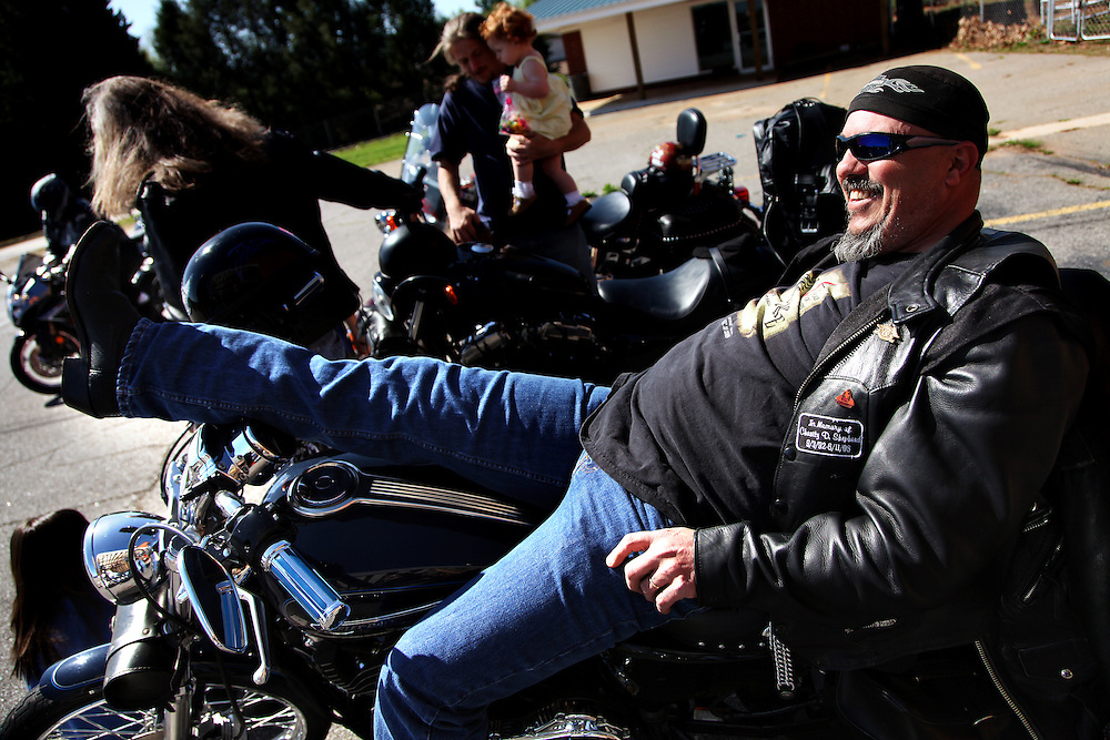 Steve Whisnant relaxes for a moment with fellow bikers shortly before Sunday services begin at Crossfire United Methodist Church in Wilkesboro, N.C.