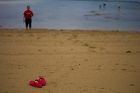 Chinese Tourists red sandals on the beach at Sanur. Bali revisited January 2012.