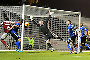Rochdale goalkeeper Conrad Logan (25) makes an important save during the EFL Sky Bet League 1 match between Northampton Town and Rochdale at Sixfields Stadium, Northampton, England on 17 December 2016. Photo by Dennis Goodwin.
