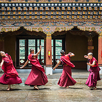 Bhutanese monks dancing at the Rinpung Dzong in Paro.<br />