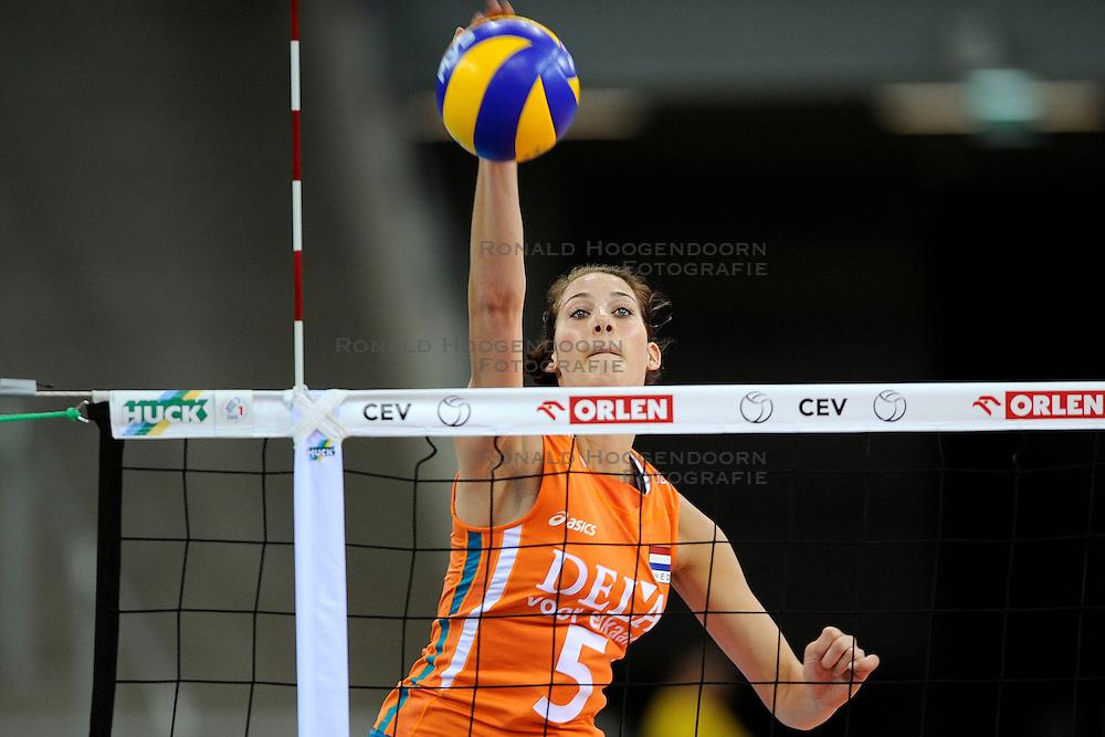 30-09-2009 VOLLEYBAL: EUROPEES KAMPIOENSCHAP NEDERLAND - BELGIE: LODZ<br /> Nederland is groepswinnaar en wint opnieuw. Belgie wordt met 3-0 verslagen / Robin de Kruijf<br /> &copy;2009-WWW.FOTOHOOGENDOORN.NL