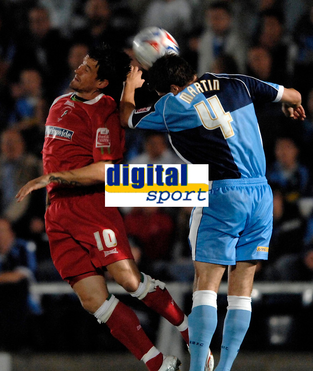 Photo: Richard Lane.<br />Wycombe Wanderers v Swindon Town. Coca Cola League 2. 26/09/2006. <br />Swindon's Lee Peacock challenges Wycombe's Russel Martin for the ball.