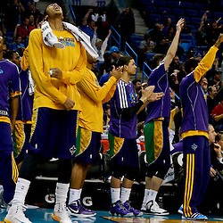 Feb 6, 2013; New Orleans, LA, USA; New Orleans Hornets power forward Anthony Davis (23) reacts with teammates after a basket against the Phoenix Suns during the fourth quarter of a win at the New Orleans Arena. The Hornets defeated the Suns 93-84. Mandatory Credit: Derick E. Hingle-USA TODAY Sports