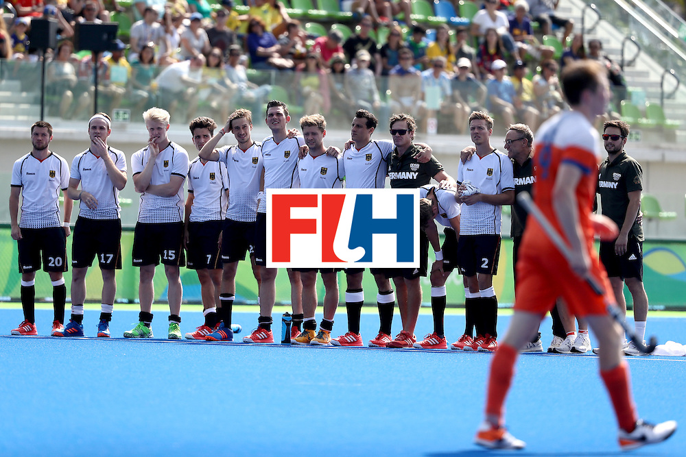 RIO DE JANEIRO, BRAZIL - AUGUST 18:  Team Germany looks on during the penalty shootout against Netherlands during the Men's Hockey Bronze medal match at the Olympic Hockey Centre on Day 13 of the 2016 Rio Olympic Games on August 18, 2016 in Rio de Janeiro, Brazil.  (Photo by Sean M. Haffey/Getty Images)