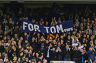 Tottenham Hotspur fans hold up a banner that reads ;FOR TOM THFC' during the UEFA Europa League match at White Hart Lane, London<br /> Picture by David Horn/Focus Images Ltd +44 7545 970036<br /> 27/02/2014