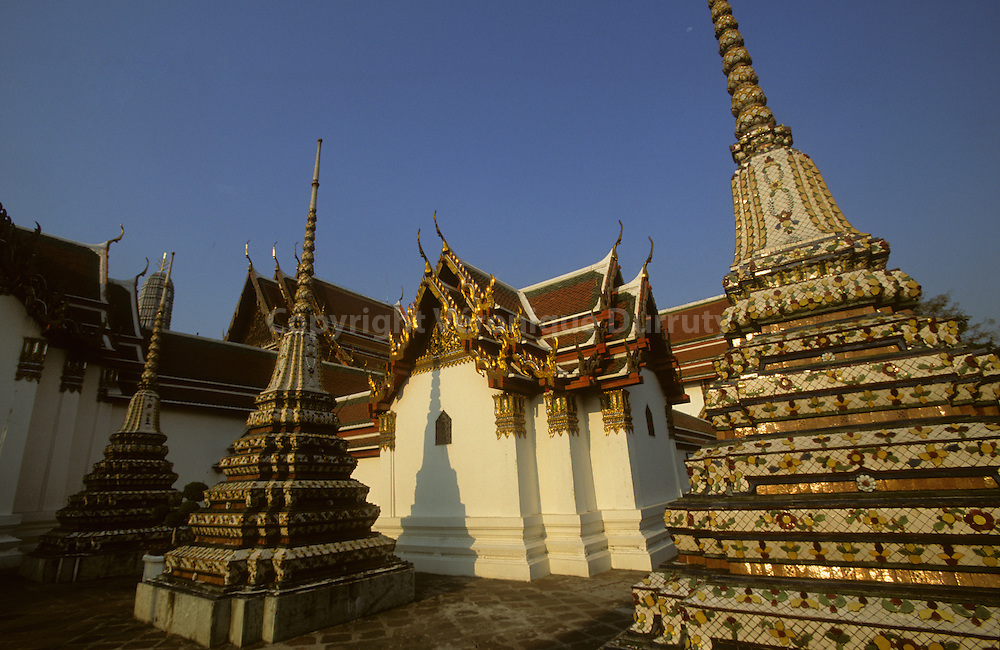 Theravada buddhism in Thailand.Wat Pho is a Buddhist temple in Phra Nakhon district, Bangkok, Thailand. Its official name is Wat Phra Chettuphon Wimon Mangkhalaram Ratchaworamahawihan