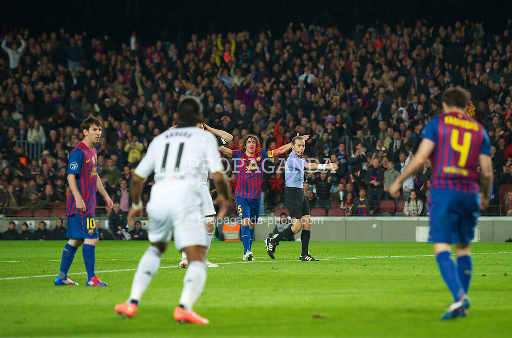 BARCELONA, SPAIN - Tuesday, April 24, 2012: Referee Cuneyt Cakir points to the spot and awards FC Barcelona a penalty against Chelsea during the UEFA Champions League Semi-Final 2nd Leg match at the Camp Nou. (Pic by David Rawcliffe/Propaganda)
