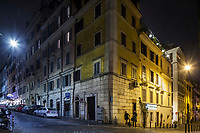 ROME, ITALY - 20 MARCH 2017: A white LED street light (left) illuminates a street, while an old sodium yellow street light illuminates the other (right), in the Monti neighborhood in Rome, Italy, on March 20th 2017.<br /> <br /> Rome is undergoing a city-wide plan to change its public illumination from the current yellow sodium street lights CK to white LED lamps. In making the change, Rome joins a long line of cities around the world that have switched to the cheaper, and more environmentally friendly LED lighting, and it is not the first city where that change has come at the price of protest.<br /> <br /> Since July, some 100,000 led lights have already been installed, just over half the number that will be substituted in the 53 million euro changeover that is expected to save the city millions of euros in electrical bills. But when Rome's municipal electrical utility ACEA began to substitute the lamps in Rome's historic center, residents began to take note.