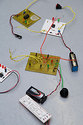 Circuit boards wired up to help students to understand how to build a prototype circuit,