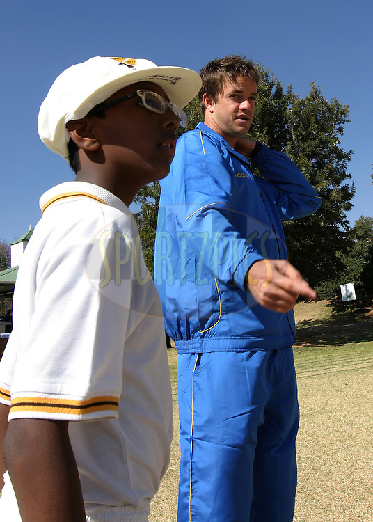 Albie Morkel with a kid from the Montrose Primary School during the CLT20 players visit to the Montrose Primary School in Benmore, Johannesburg held as part of the launch events for the Champions League T20 tournament (being held in South Africa in September 2010) on the 10 August 2010..Photo by..CLT20 / SPORTZPICS