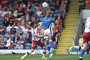 Calvin Andrew wins a header during the EFL Sky Bet League 1 match between Rochdale and Bradford City at Spotland, Rochdale, England on 21 April 2018. Picture by Daniel Youngs.