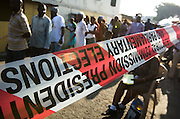 People stand in line to vote at a polling station in Ghana's capital Accra during presidential and parliamentary elections on Sunday December 7, 2008.