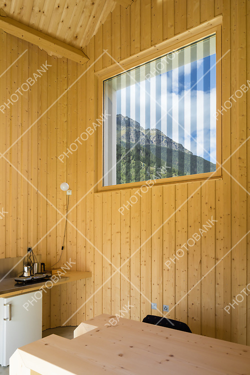 Wooden wall with window in a kitchen