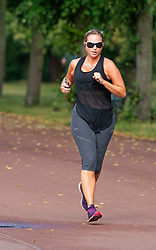 ©Licensed to London News Pictures 03/07/2020     <br /> Greenwich, UK. A lady running in the park. A sunny morning in Greenwich Park, Greenwich, London as people make a positive start to the day with some exercise. Photo credit: Grant Falvey/LNP