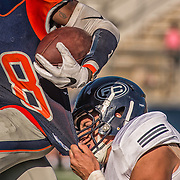 Orange Coast College #18 gets tackled by Fullerton Junior College defense.