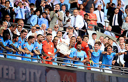 Manchester City players celebrate with the Community Shield after winning the Community Shield match at Wembley Stadium, London.