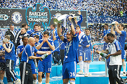 LONDON, ENGLAND - Sunday, May 9, 2010: Chelsea's captain John Terry is sprayed by assistant manager Ray Wilkins and team mate Michael Essien after winning the 2009/10 Premier League Trophy during the final Premiership match of the season at Stamford Bridge. (Pic by Gareth Davies/Propaganda)