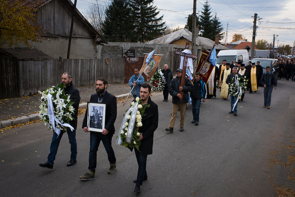 Mourners lead a funeral procession for Ionuț Popescu, who died Saturday from injuries sustained in the fire at Colective Club, on November 10, 2015 in Râmnicu Sarat, Romania.