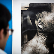 NAGASAKI, JAPAN - AUGUST 9 : Visitors look at old photos of atomic bomb victims exhibited at Nagasaki Peace Park in Nagasaki during the 71st anniversary of the atomic bombing on Nagasaki, southern Japan, Tuesday, August 9, 2016. Japan marked the 71st anniversary of the atomic bombing on Nagasaki. On August 9, 1945, during World War II, the United States dropped the second Atomic bomb on Nagasaki city, killing an estimated 40,000 people which ended World War II. (Photo by Richard Atrero de Guzman/NURPhoto)