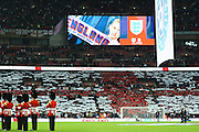 England fans making a flag during national anthem during the Group E UEFA European 2016 Qualifier match between England and Estonia at Wembley Stadium, London, England on 9 October 2015. Photo by Alan Franklin.