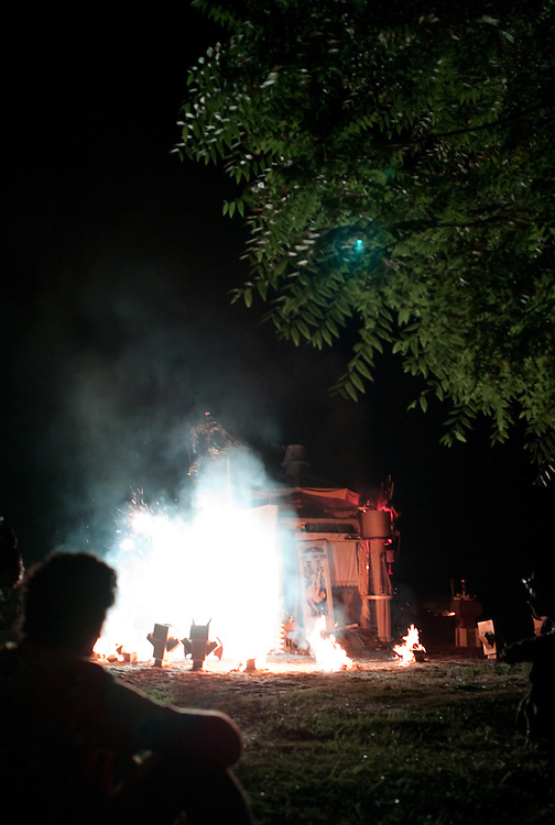 Fireworks go off as the Effigy burns.  Lee Mayjahs looks on.