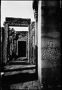 An apsaras carved into a column of Bayon.